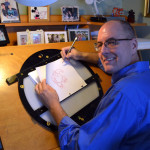 Tom Bancroft at his art desk