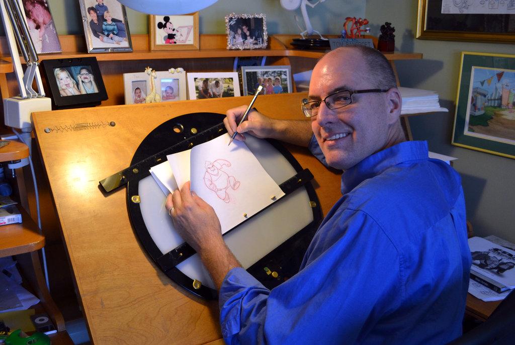 Tom Bancroft at his art desk